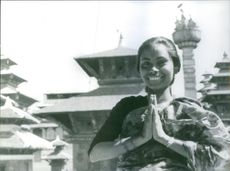 A Nepali women is showing her obeisance with smiling face