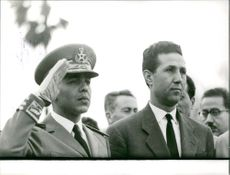 Ahmed Ben Bella with a man.