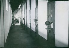 1939 Cells at St. Joseph. for fresh air, The prisoners thrust their heads through the holes in the door.
