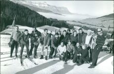 Olivia Gendebien having a group photo with other people in the ski resort.  - Jan 1964