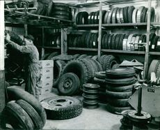 A worker working in a Tyre factory.
