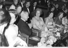 The Duke and Duchess of Windsor enjoying meal along with a conversation at a function.