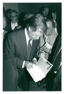 Vaclav Havel signs his book Symposion Library at the Historical Museum