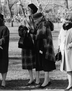 People who admire and love John F. Kennedy mourn during the President's funeral, 1963.