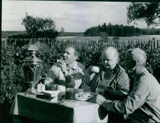 Oleg Popov with his parents at their dacha (country home) near Moscow, 1969.