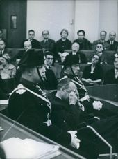 """People sitting in a courtroom.   """"Jaccoud""""  1960"""