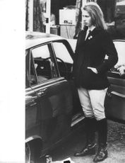Princess Anne standing with car.