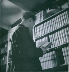 1940 Man with book at the Royal Library