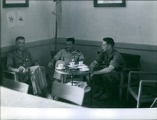 Soldiers sitting around a table in Algeria.