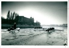 The Oxford trial eights pass the Harrods depository.