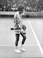 American tennis player Arthur Ashe leaves the track after the semifinal of the Masters