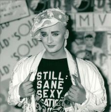 Boy George showing off the prints of his shirt