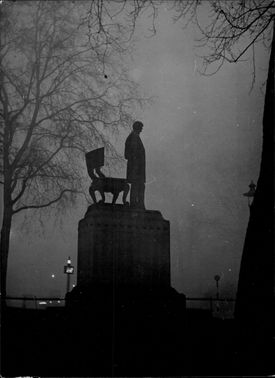 The Abraham Lincoln statue is seen through the fog outside the Houses of Parliament building in Parliament Square