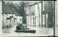 Floods 1966-1989:Peter watson using the family canoe.