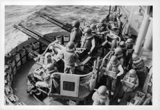 US Navy sailors using their armory.