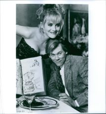 """Sharon Stone and Kevin Bacon on the set of the film """"He Said, She Said""""."""