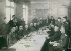Soldiers gathered while having a meeting during the WWI, 1936.