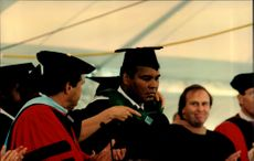 Muhammad Ali receives the title of Honorary Doctor in Law, for his sports and humanitarian efforts, on Mount Ida Collage.