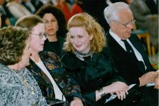 Suha Arafat siting with other people in a event.