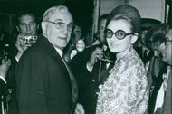 Vintage photo of Charles-Marie Vanel and wife surrounded by media men. Photo taken on May 6, 1970.