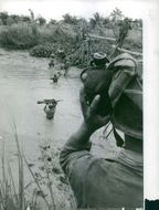 Soldiers crossing the river in Vietnam.