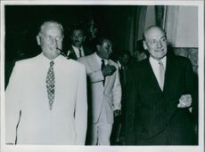 Mr. Attles and President Tito (smoking cigarette in pipe) pictured together at the reception in Bled, 1953.