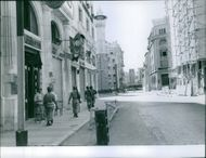 Some Lebanese soldiers are walking on the pavement during 1958 Lebanon crisis, while road is empty