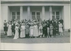 men and women gather for group photograph.