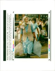 This elderly peasantwoman brought along her possessions in two bags.