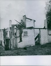 Soldiers siting and jumping from the wall.