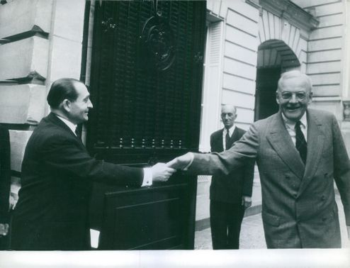 Pierre Mendes France shaking hand with man.