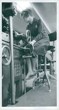 Birgitta Pettersson controls the perforation on the running stamps on Posten's stamp printing
