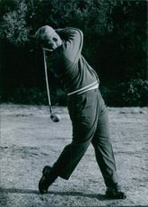 A photograph of Mr. Jack Nicklaus when he was playing golf.