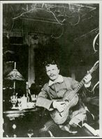 August Strindberg plays the guitar