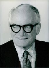 U.S. Senator Barry Goldwater photographed with a beaming smile. 1984.