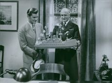 """A scene from the film """"Family Secret"""" casting by Olof Winnerstrand and Kotti Chave, 1936."""