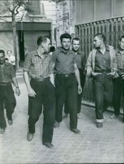 Group of men walking together.