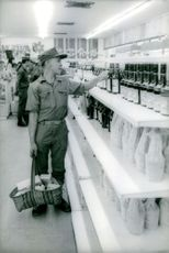 Vietnamese soldier buying his personal things. February 6, 1973