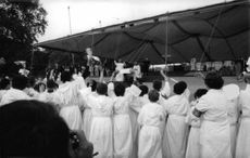 Pope Paul VI communicating with crowd.