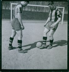 Two men playing football in ground. 1944