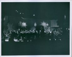 Portrait of  a Danish comedian, conductor, and pianist  Victor Borge performing with other people during an event.