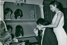 Jacques Dessange trying a wig to a man. Photo taken on June 20, 1966.