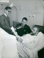 Producer Ingvar Lundin and Associate Professor Tomas Hammar discuss recording techniques with Professor Per Sundberg at Danderyd's Lasarett