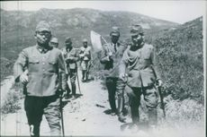 Japanese parliamentarians march towards the Russo-Soviet border to confer with Soviet officers.