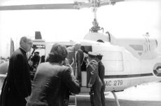 Pope Paul VI stepping out of helicopter.