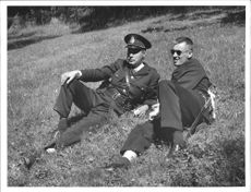 Poilceofficers taking a break in the grass