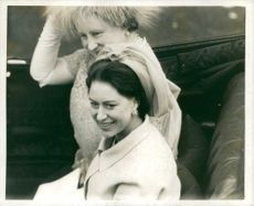 Charles, Prince of Wales`s mother and aunt smiling.