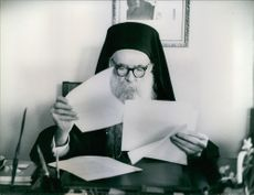 Athenagoras I reading papers. 1967.