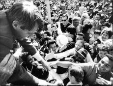 """Robert Francis """"Bobby"""" Kennedy shaking hands with crowd."""