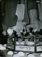 Group of men at a store during the Kejne affair.